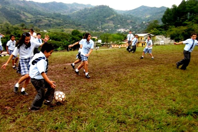 0830ov kids in Honduras playing on the local soccer field.jpg
