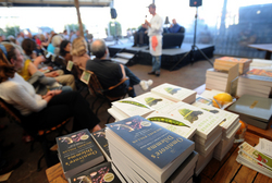 Maxwell - Pollan books in the foreground as Chef Alex speaks