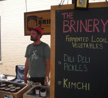 Borden - David K in front of Brinery sign