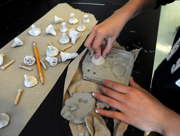 Dexter creekside intermediate students learn art history for Clay mural making