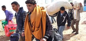 0319 Libyan refugees flee to Tunisian border.jpg