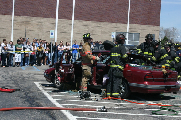 firefighters_work_on_car_students-Watch.JPG