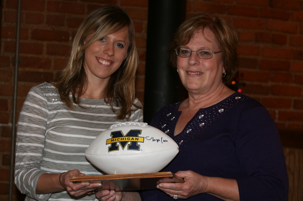 Tina_and_Pat_ Reed_hold_an_ autographed_ football.JPG