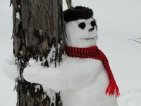 Thumbnail image for tree-hugging-snowman.jpg