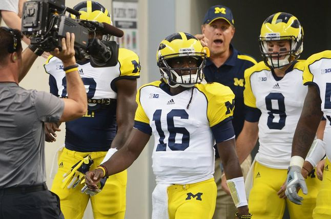 michigan-players-arrive.jpg