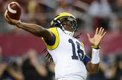 um-fb-denard-throw.jpg
