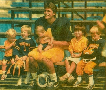 JimHarbaugh_with_children.jpg