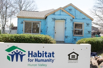 city of ypsilanti to buy homes sell them to habitat for
