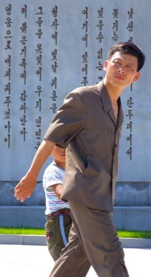 Father-and-son-lg-at-Revolutionary-Martyrs-Cemetery-North-Korea.jpg