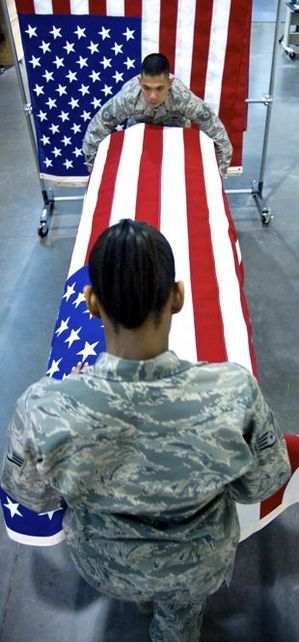 HONORINGHonoring-the-Fallen-as-Two-sergeants-drape-a-flag-over-a-coffin.jpg