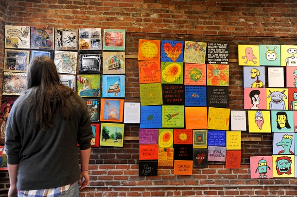 Saline resident Jeff Pando stares at the artwork of Sol Bermann at the 30x30 show at the Ann Arbor Art Center on Saturday afternoon. This is the center's 3rd annual event, where 30 artists each create 30 works in 30 days to benefit the Art for Kids program. Angela J. Cesere | AnnArbor.com