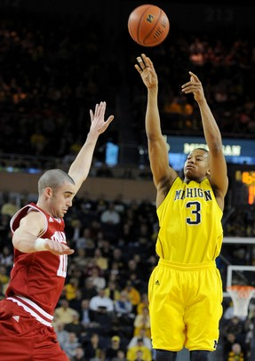 Michigan guard Trey Burke jumps up for a shot while Indiana forward Will Sheehey tries to block him. Angela J. Cesere | AnnArbor.com