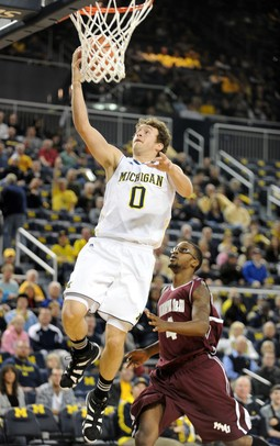 Michigan forward Zack Novak goes up for a layup. Angela J. Cesere | AnnArbor.com