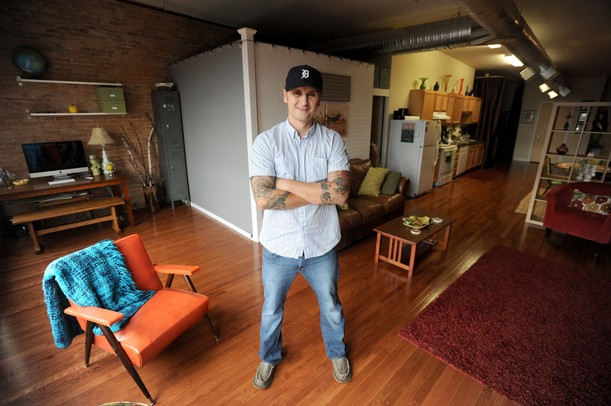 Mark Serra stands inside of his apartment above Herbal Solutions on Michigan Ave in downtown Ypsilanti. Angela J. Cesere | AnnArbor.com