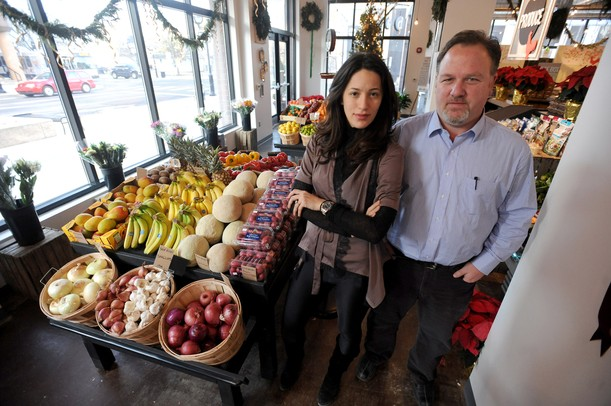 Sava Lelcaj, owner of babo, left, stands with general manager Paul Hannah in front of the produce section of the new babo market on E. Washington St.  Angela J. Cesere | AnnArbor.com