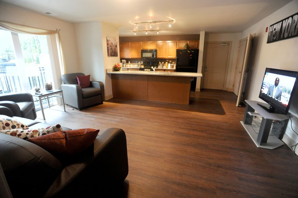 Developer offers first glance inside ann arbor 39 s new city for Living in a model apartment