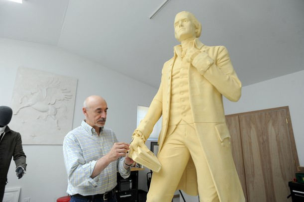 In his Saline studio, sculptor Tony Frudakis smoothes out the urethane foam that will be used to make a mold for a statue of Thomas Jefferson. The statue, which is being made for Thomas Jefferson High School in Council Bluffs Iowa, will be cast in bronze.  Angela J. Cesere | AnnArbor.com