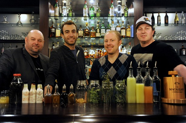 From left:  The Last Word co-owners Paul Drennan, Adam Lowenstein, Robbie Schulz, Justin Herrick, stand behind the bar filled with specialty drink mixers. The Last Word recently opened in the space of the former Goodnight Gracie. Angela J. Cesere | AnnArbor.com