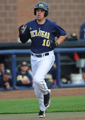 Michigan sophomore Michael O'Neill runs home on a hit from teammate Coley Crank during the baseball game against Coastal Carolina University at Wilpon Baseball Complex in Ann Arbor, Mich. on Tuesday evening. Angela J. Cesere | AnnArbor.com