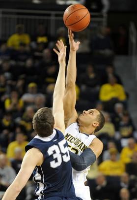 Michigan forward Jordan Morgan and Penn State forward Billy Oliver face off for the jump ball. Angela J. Cesere | AnnArbor.com