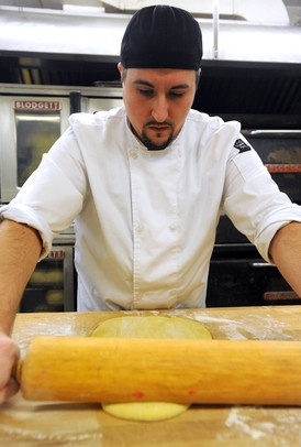 After making the ultra-rich paczki dough, which includes eggs, flour, butter and a touch of alcohol, Weber's production baker Jerry Alcenius rolls out the dough for the first test batch of paczki. Test batches are made to ensure that when paczki day comes, the dough and process have been perfected. Angela J. Cesere | AnnArbor.com