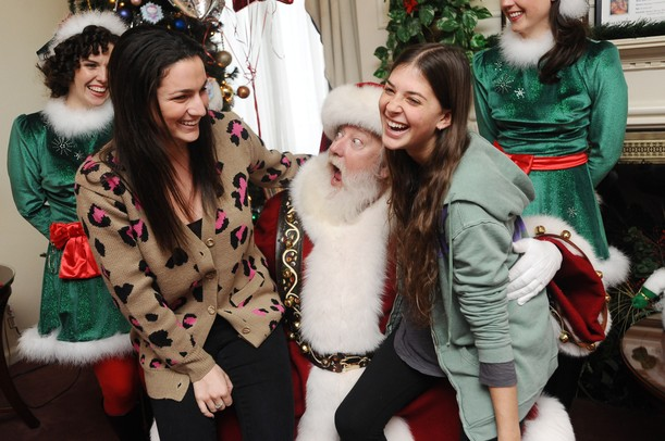 Santa reacts to the request of sophomore Nicole Barron, of West Bloomfield, for a good GPA for Christmas as her sorority sister sophomore Hillary Wiesel laughs during a Make-A-Wish event at the Chi Omega Sorority house on Tuesday.  Melanie Maxwell I AnnArbor.com