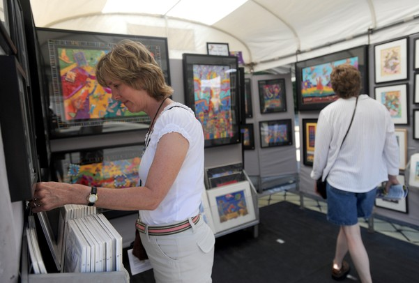 Battlecreek resident Julie Awkerman browses through the fiber art of Michael Lewis at Ann Arbor's South University Art Fair on South University. Angela J. Cesere | AnnArbor.com