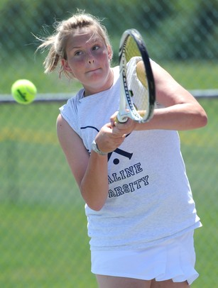 Saline's Heather Vogt hits the ball in the 3 singles match against Pioneer's Diya Malhotra at a tournament at Pioneer High School on Wednesday afternoon. Angela J. Cesere | AnnArbor.com