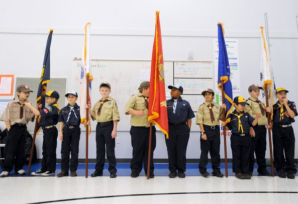 Great Saux Trail Council cub scout pack 284 holds a flag for each branch of the military during a ceremony held by the school to honor veterans on National Veterans Day. Angela J. Cesere | AnnArbor.com