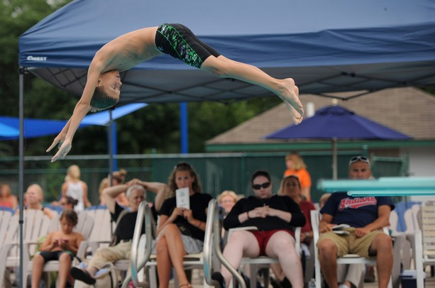 10-year-old Chippewa diving team member Nicholas Kaipainen dives off the springboard during Washtenaw Interclub Swim Conference (WISC) 9- and 10-year-old diving championships at Georgetown Country Club pool in Ann Arbor on Thursday afternoon. Angela J. Cesere | AnnArbor.com