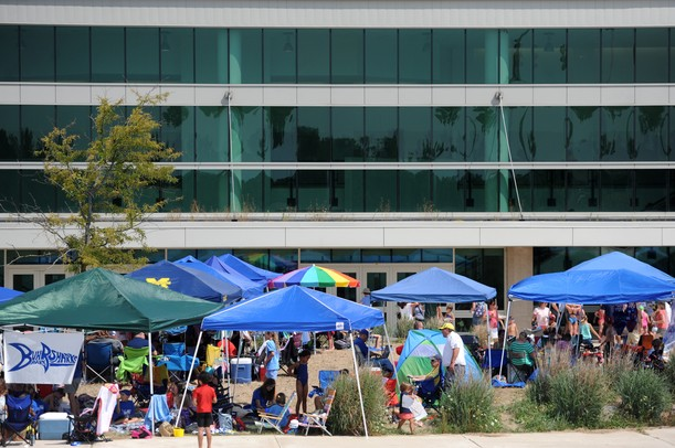 Tents line the sidewalks outside of Skyline High School for the third day of the Washtenaw Interclub Swim Conference (WISC) swimming championships. Wednesdays swimmers were boys and girls ages 8 and under. Angela J. Cesere | AnnArbor.com