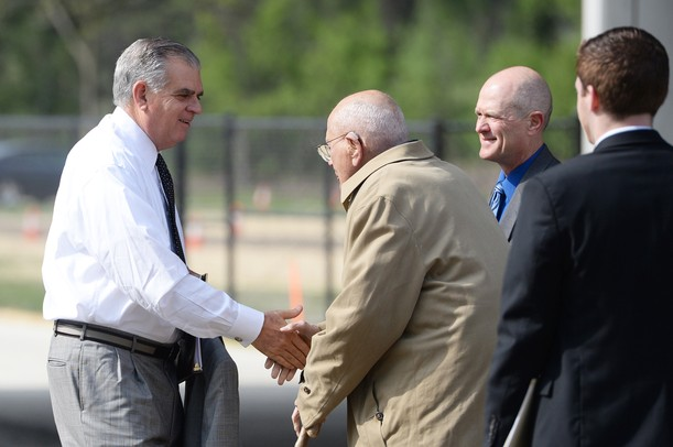 Transportation Secretary Ray LaHood greets U.S. Rep. John Dingell as Ann Arbor Mayor John Hieftje looks on before a dedication ceremony for the Stadium Bridges project on Tuesday, May 14, 2013. Melanie Maxwell I AnnArbor.com