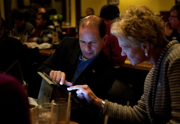 WISD Superintendent Scott Menzel gets an update on election coverage at the Tower Inn Cafe in Ypsilanti on Tuesday. Menzel is optimistic about early trends and reports. Daniel Brenner I AnnArbor.com