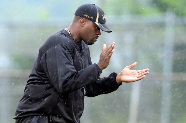 Ypsilanti Community High School defensive line and offensive line coach Dion Powell looks to motivate the team during practice in the rain at the school on Monday, August 12, 2013. Melanie Maxwell | AnnArbor.com