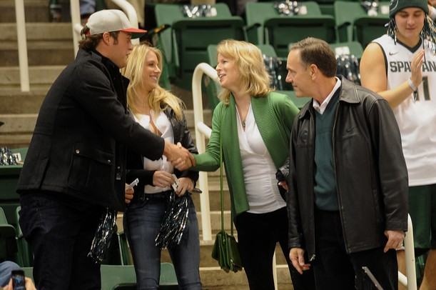 Detroit Lions quarterback Matthew Stafford shakes hands with Becky Dantonio as her husband and Michigan State head football coach, Mark stands by at Breslin Center in East Lansing on Tuesday, Feb. 12. Melanie Maxwell I AnnArbor.com