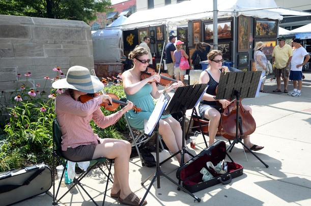 Musicians perform on the corner of  E. William St. and S. Thompson St. on Wednesday, July 17, 2013. Melanie Maxwell | AnnArbor.com