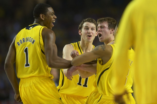 images from michigans 8276 national championship loss to