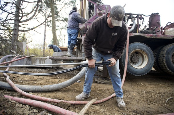 Cribley Drilling Company worker Matt Wing works in Paul Hickman's backyard as they crew installs a geo-thermal well. Melanie Maxwell I AnnArbor.com