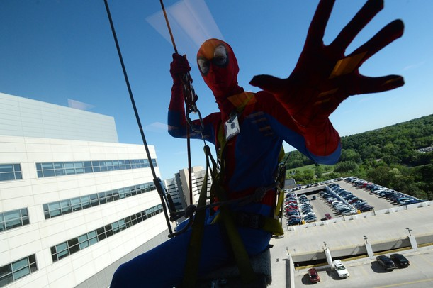 Spiderman is seen hanging from a rope outside of an eighth-floor window at C.S. Mott Children's Hospital on Monday, June, 3, 2013. Melanie Maxwell I AnnArbor.com