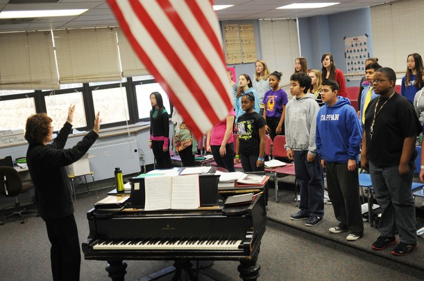 "Tappan Middle School choir director Bonnie Kidd conducts eight graders during class at Tappan on Thursday, Jan. 17. Members of the Tappan band, choir and orchestra are headed to Washington D.C. in June to perform a concert on the steps of the Lincoln Memorial to commemorate the 50th anniversary of Martin Luther King Jr.'s ""I have a dream"" speech. Melanie Maxwell I AnnArbor.com"