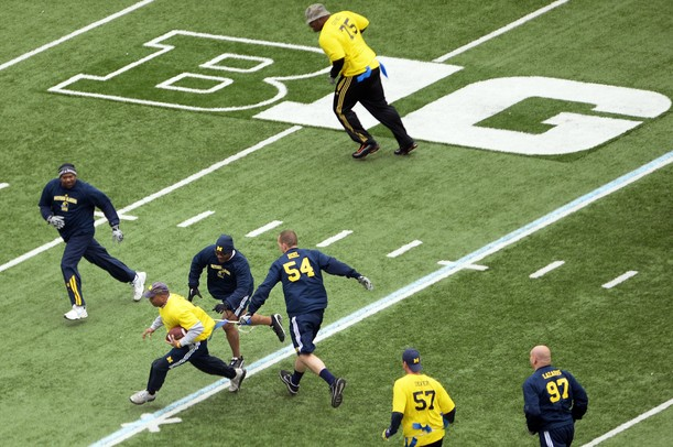 Former University of Michigan football players participate in the annual alumni flag football game before spring practice at Michigan Stadium on Saturday, April 13, 2013. Melanie Maxwell I AnnArbor.com