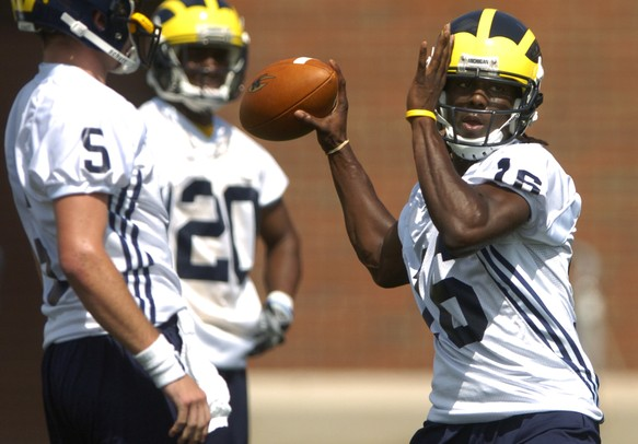 University of Michigan freshman Denard Robinson looks to pass during the first official day of practice at the outdoor football practice facility on Monday afternoon.  Melanie Maxwell | AnnArbor.com