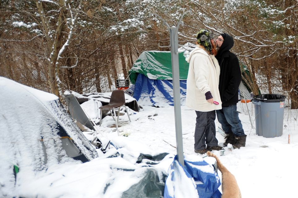 Alanna Gehringer kisses her fiance Anthony (no last name given) after putting & Itu0027s been a mild winteru0027 for 2 dozen homeless living in tent city ...