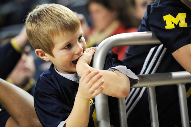 Five-year-old Kenyon Bushinski, of Jackson, waits for the team to take the court at Crisler Center on Tuesday. Melanie Maxwell I AnnArbor.com