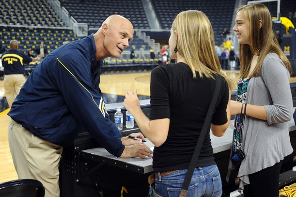 Michigan women's basketball coach Kevin Borseth chats with fans as he signs autographs during an open house at Crisler Arena on Friday evening. Melanie Maxwell I AnnArbor.com
