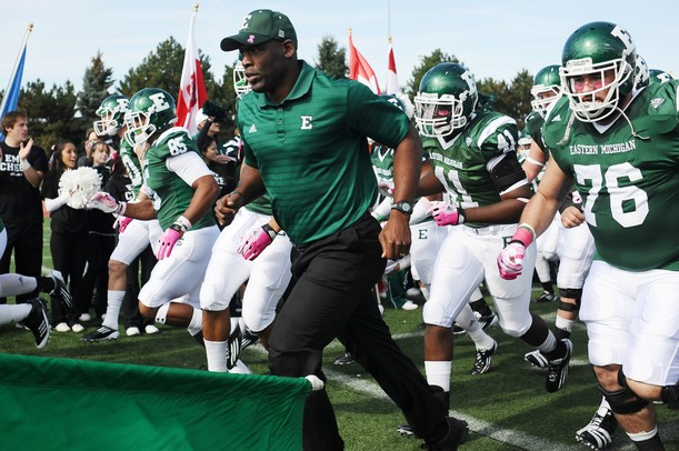 Eastern Michigan head coach Ron English leads his team on to the field before the start of their game against Western Michigan at Rynearson Stadium on Saturday afternoon. Melanie Maxwell I AnnArbor.com