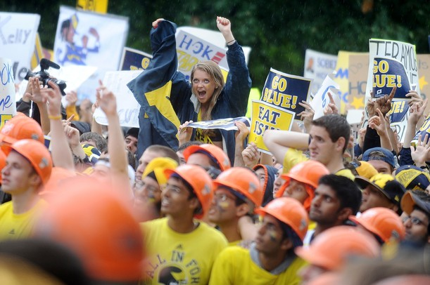 Michigan fans cheer and hold signs during a live broadcast of ESPN Game Day at Ingalls Mall on Saturday morning. Melanie Maxwell I AnnArbor.com