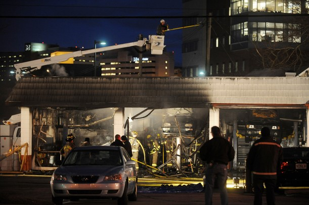Ann Arbor firefighters work to put out a fire at Broadway Auto Care on Monday night. Melanie Maxwell I AnnArbor.com