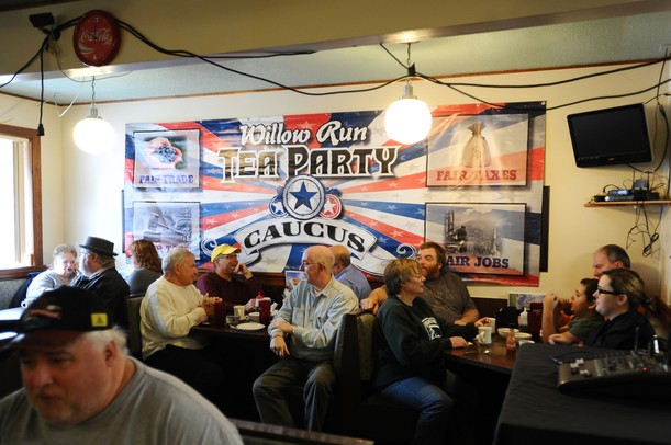 Supporters wait for Republican presidential candidate Herman Cain to make an appearance at the Big Sky Diner in Ypsilanti during a stop on Thursday morning. Melanie Maxwell I AnnArbor.com