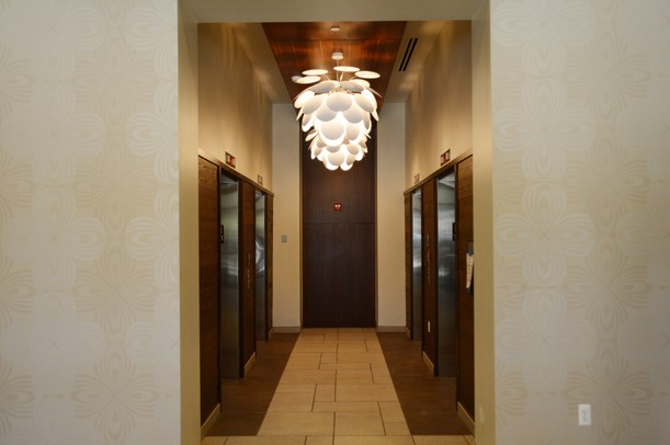 A funky chandelier hangs near the elevators at Landmark. Melanie Maxwell I AnnArbor.com